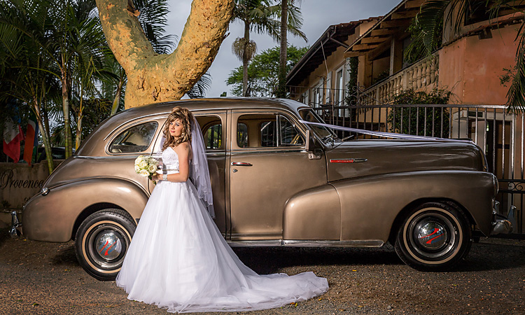 Bride Showing some style next to old vintage car