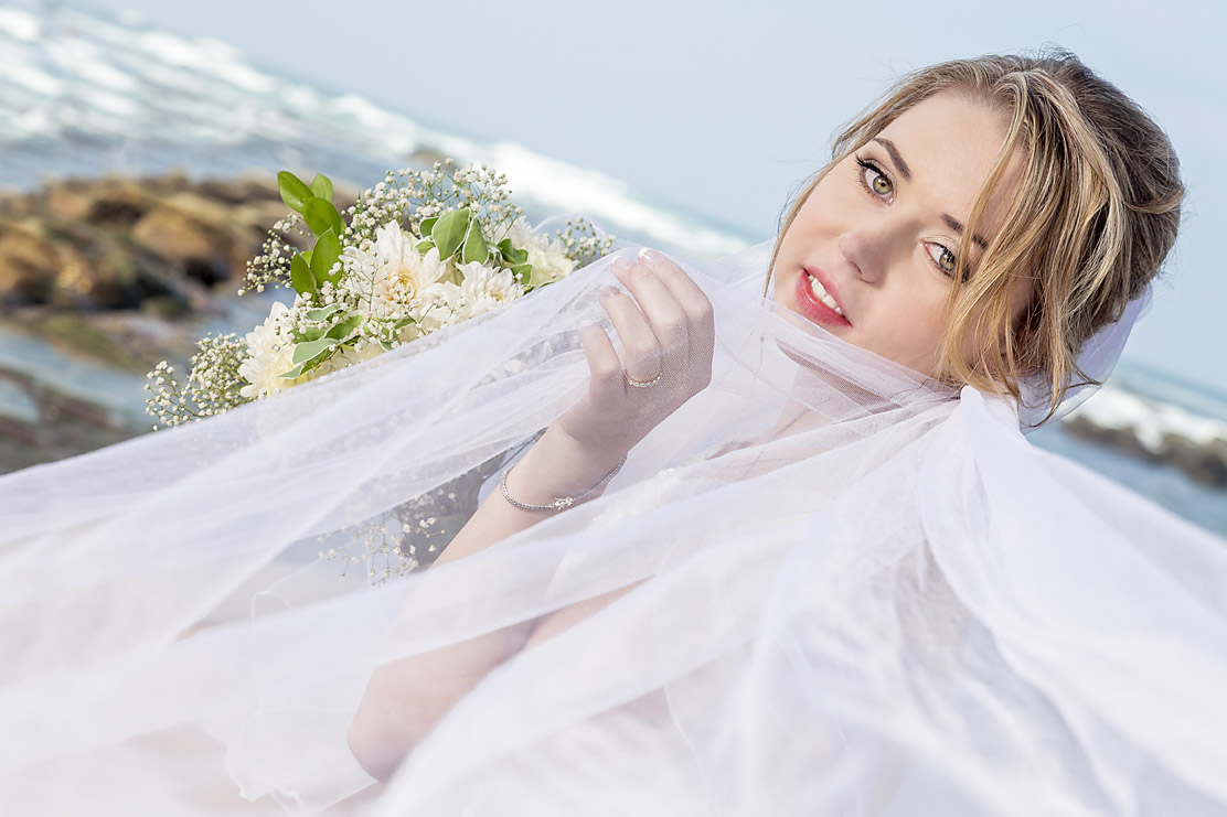 Bride enjoying her formal photoshoot on the beach with Sam Basson.